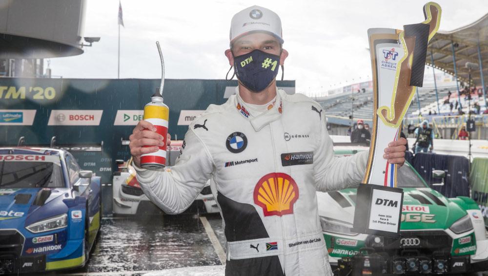 Sheldon van der Linde celebrates his first DTM win wearing a mask