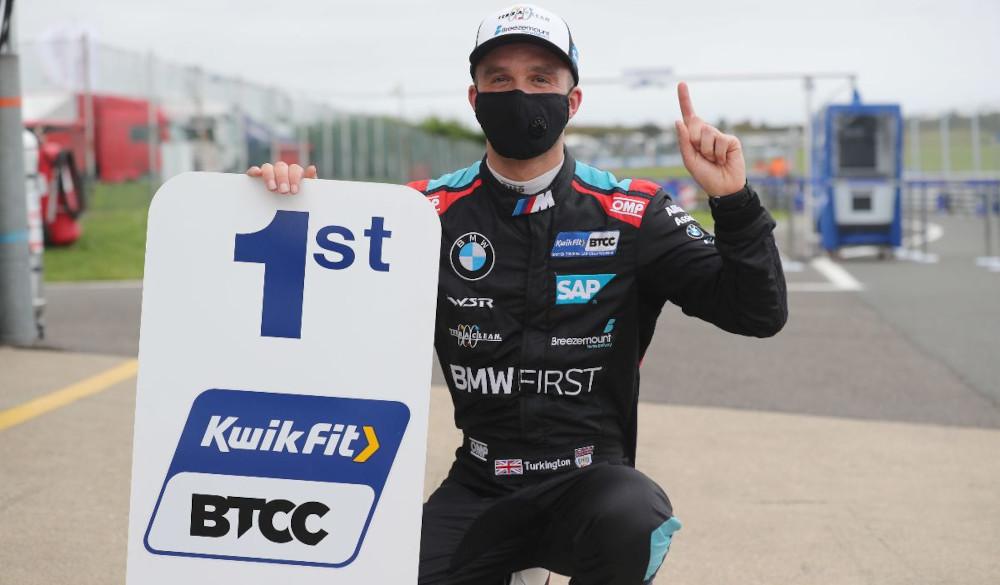 Colin Turkington celebrates whilst wearing a mask