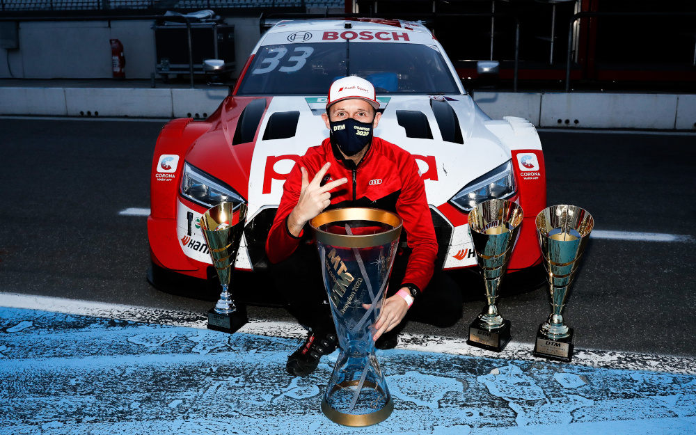 René Rast celebrates with his trophy whilst wearing a mask