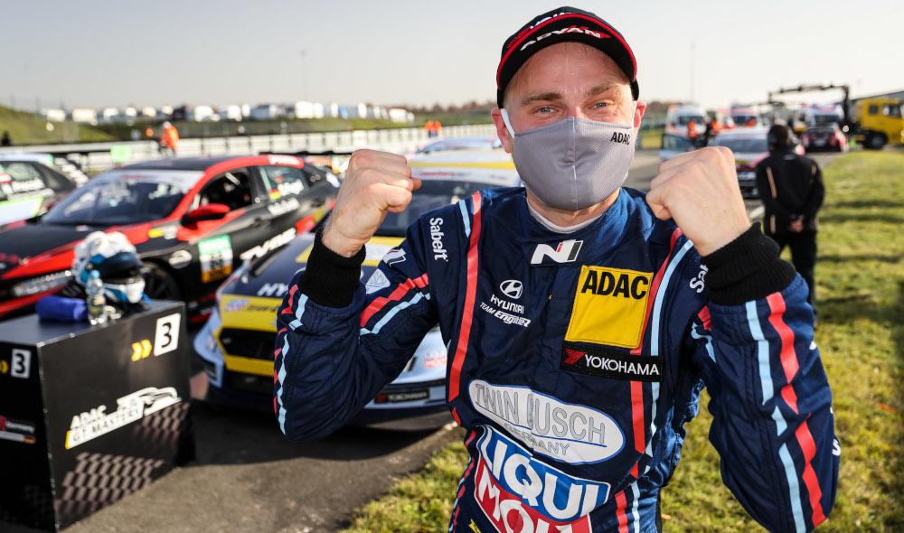 Antti Buri celebrates whilst wearing a mask