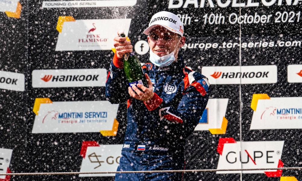 Klim Gavrilov celebrates on the podium whilst wearing a mask